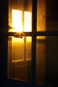 Sunset through salt spray windows